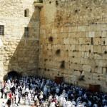 Jewish men praying at Western wailing wall