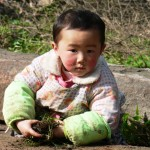 Toddler playing Mt Emei trail