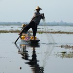 Fisherman paddling Inle Lake