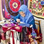 Embroidering suzani